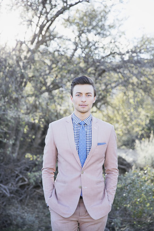 Groom in pale pink suit with blue checkered shirt and polka dot tie
