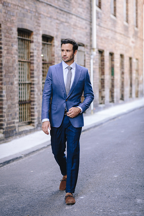 a tailored suit elongates your frame and makes you look good