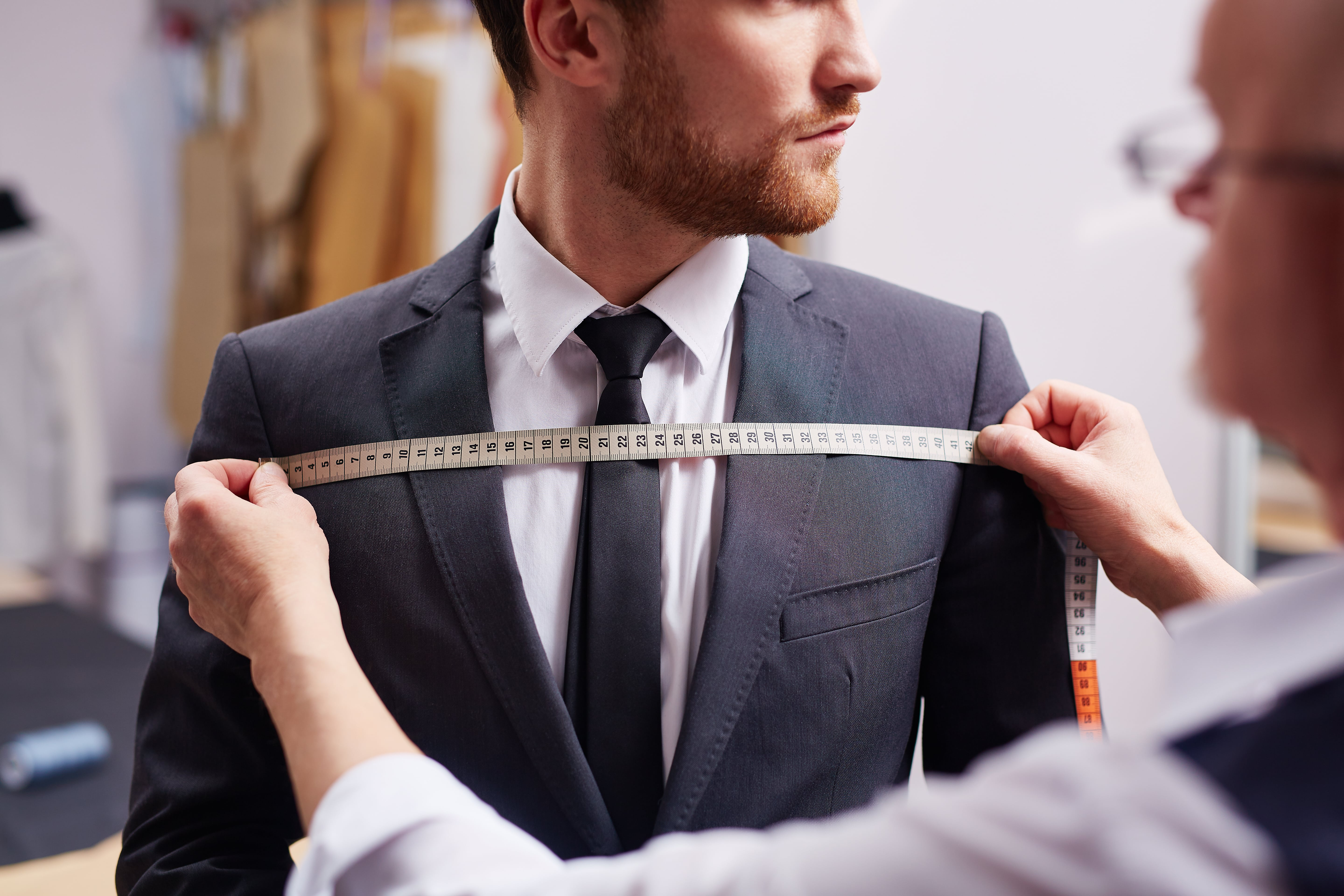 a man getting a custom-made tailored suit