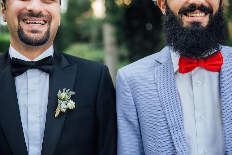 groom and groomsman wearing bow ties