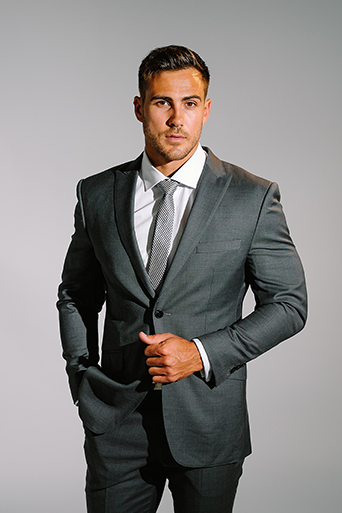 business formal dark grey suit with silver tie and white shirt