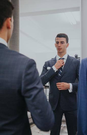 custom-tailored suit fitting