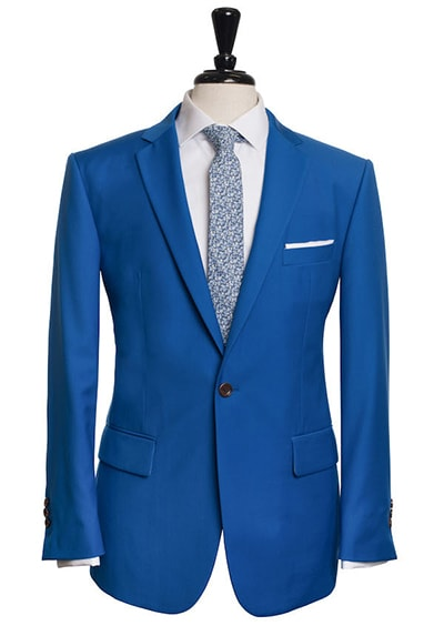 bright electric blue suit with blue floral tie and flap pockets