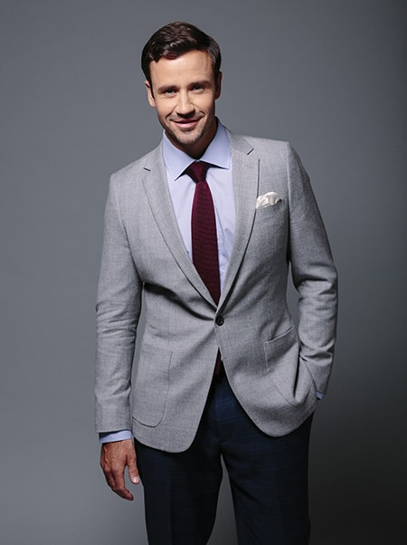 light grey blazer with patch pockets and red tie