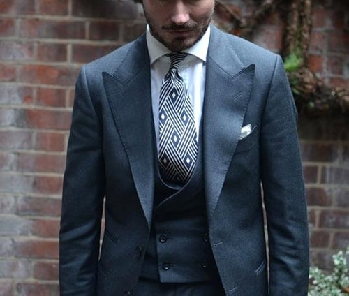 steel blue wide peak lapel suit with diamond tie