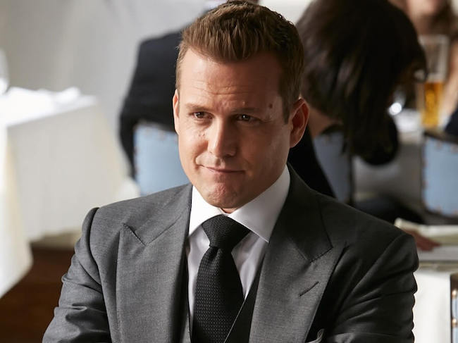 Harvey Spector wearing a Full Windsor or Double Windsor knot tie