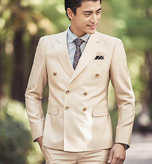 Groom in beige double-breasted suit