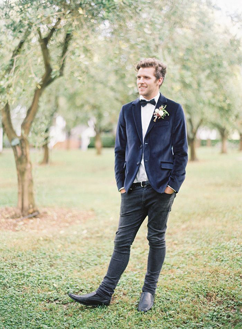 Groom in blue velvet suit and jeans