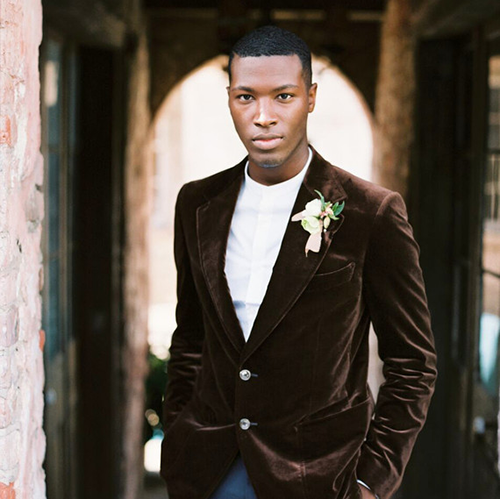 Groom in brown velvet suit jacket and jeans