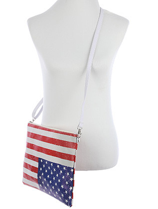 BAG ACCESSORY / STARS AND STRIPES PRINT / VINYL CROSSBODY CLUTCH / RED WHITE AND BLUE / AMERICAN FLAG / FLAG IS UPSIDE DOWN ZIP CLOSURE / REMOVABLE ADJUSTABLE STRAP / INNER LINING / SLIP POCKET / ONE SIZE / 13 INCH WIDE / 10 INCH TALL / NICKEL AND LEAD COMPLIANT