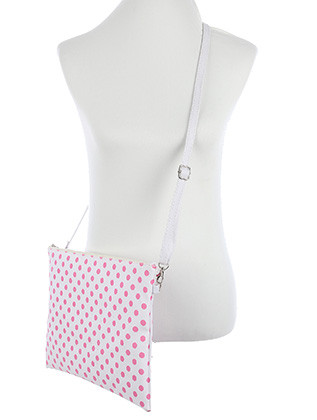 BAG ACCESSORY / POLKADOT PRINT / VINYL CROSSBODY CLUTCH / ZIP CLOSURE / REMOVABLE ADJUSTABLE STRAP / INNER LINING / SLIP POCKET / ONE SIZE / 13 INCH WIDE / 10 INCH TALL / NICKEL AND LEAD COMPLIANT
