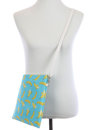 BAG ACCESSORY / BANANA PRINT / VINYL CROSSBODY CLUTCH / ZIP CLOSURE / REMOVABLE ADJUSTABLE STRAP / INNER LINING / SLIP POCKET / ONE SIZE / 13 INCH WIDE / 10 INCH TALL / NICKEL AND LEAD COMPLIANT