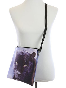 BAG ACCESSORY / BLACK PUMA PRINT / VINYL CROSSBODY CLUTCH / ZIP CLOSURE / REMOVABLE ADJUSTABLE STRAP / INNER LINING / SLIP POCKET / ONE SIZE / 13 INCH WIDE / 10 INCH TALL / NICKEL AND LEAD COMPLIANT