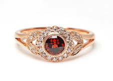 10K ROSE GOLD - VINTAGE BEZEL SET GARNET & DIAMOND FASHION RING (0.13CT)