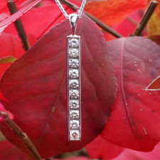 14K WHITE GOLD,  10RD = 0.65CT, CHANNEL SET DIAMOND ICICLE PENDANT WITH CHAIN