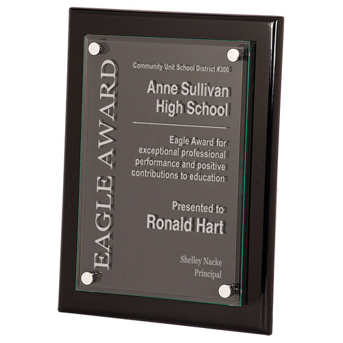 Gorgeous black piano finish corporate award plaque with custom graphics on a floating acrylic.