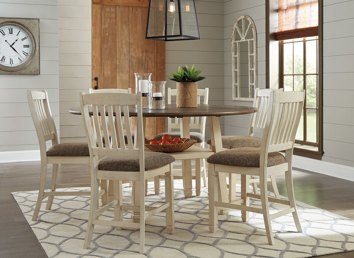 Picture of: The Bolanburg Two Tone 7 Pc Round Drop Leaf Dining Set Sold At Outten Brothers Of Salisbury Serving Salisbury Maryland And Surrounding Areas