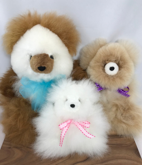 """Large (12""""), Medium (10""""), and Tiny (5.5"""")Teddies. Natural colors vary."""