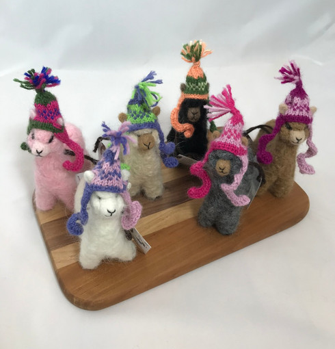Alpacas available in white, pink, tan, black, gray, and camel. Hats vary in color, but feel free to request a color preference in the comments when you order.