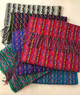 This lovely woven scarf is available in Silver Gray, Black/Rainbow, Blue, Magenta, Green, and Turquoise.