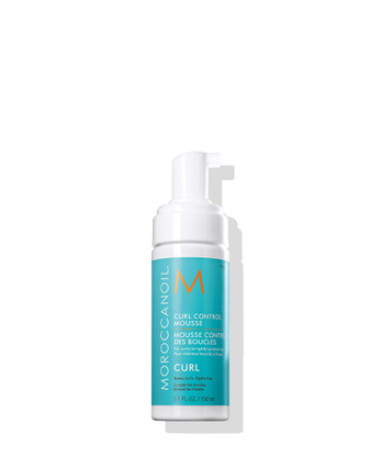 Moroccanoil® Curl Control Mousse tames, defines and provides hold for hours, sealing in moisture and preventing frizzy hair in any weather.