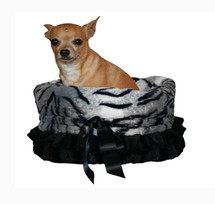 3-In-1 Reversible Siberian Tiger Snuggle Bug functions as a pet bed, a car seat or a shoulder tote.
