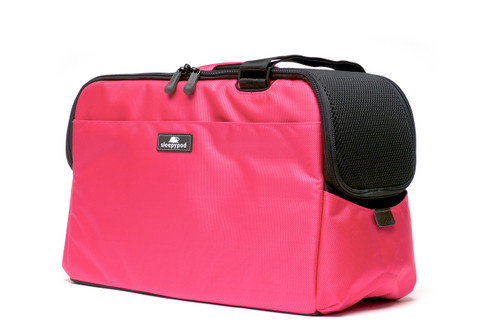 Pink Sleepypod Atom Airline Approved Pet Carrier features mesh windows for ventilation and pet visibility