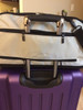 Sleepypod Air Silver Airline Approved Pet Carrier slides over luggage handles for easy maneuvering through busy airports