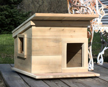 Roof overhang, side window and front door with grit strip on deck are all standard features of our outdoor feral cat shelter house