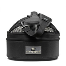 Jet Black Sleepypod Mini Pet Carrier, Car Safety Seat, Bed has multiple mesh windows for ventilation and pet visibility