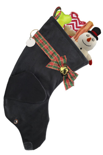 """Black Labrador Retriever dog stocking features faux fur fabric, black eye & nose accents, plaid ribbon """"collar,"""" bow & hanger, gold-tone bell & a paper ID tag hangs from the d-ring.  Sorry, but the toys are NOT included."""