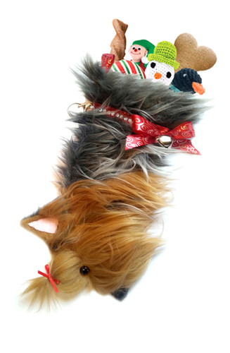 "Yorkshire Terrier Christmas Holiday Dog Stocking features faux fur fabric, black eye & nose accents, red satin swirled ribbon ""collar,"" bow & hanging loop, red satin top knot tie, silver-tone jingle bell & a paper ID for personalization.  Sorry, but the toys are NOT included."