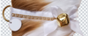 Cavalier King Charles Spaniel Christmas Holiday Dog Stocking has a white satin ribbon collar with gold rhinestone trim, a white satin bow & hanging loop, and a gold-tone jingle bell & d-ring from which hangs a paper ID tag for personalization.