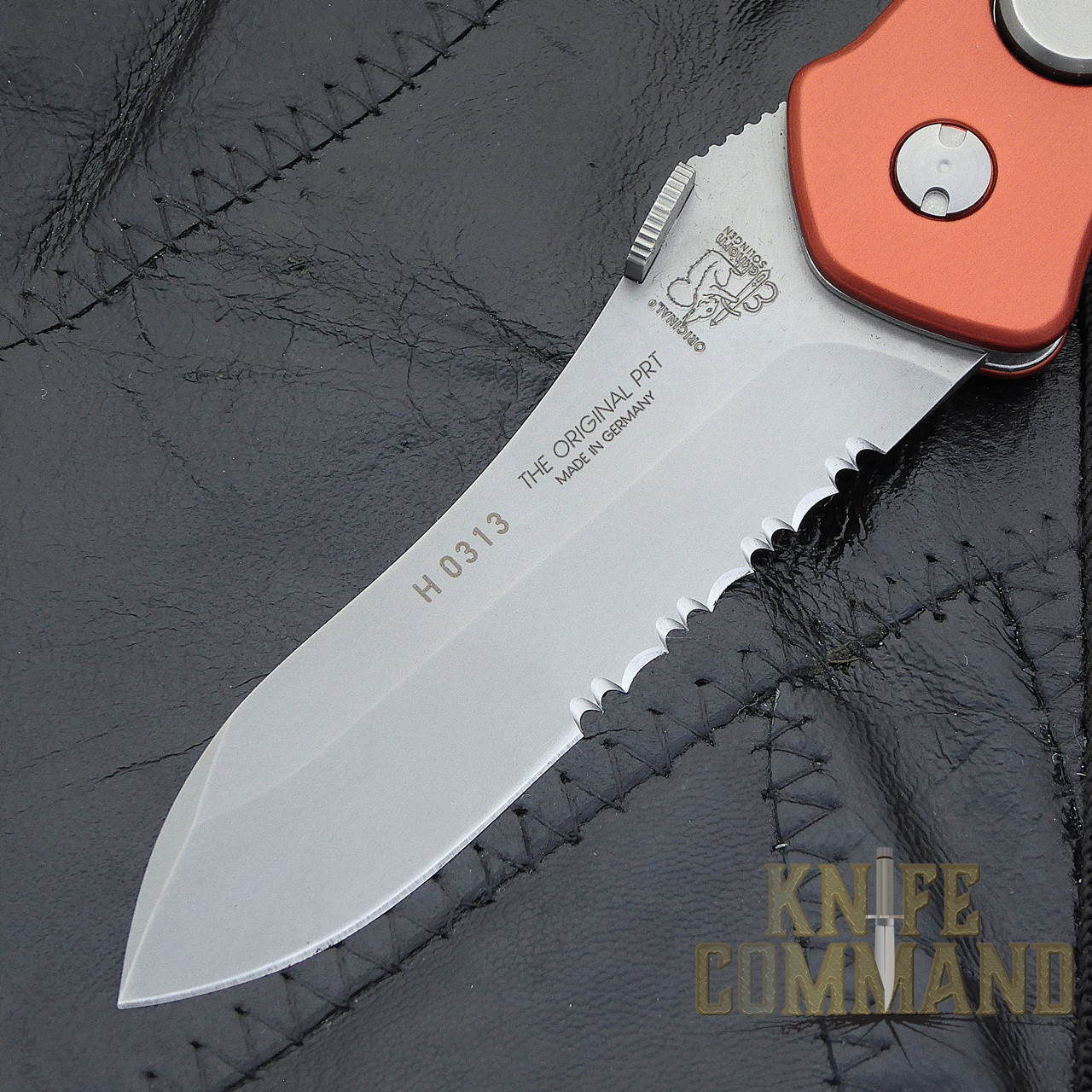 Eickhorn Solingen PRT II Red Firefighter Emergency Rescue Knife.  Spearpoint blade with serrations.