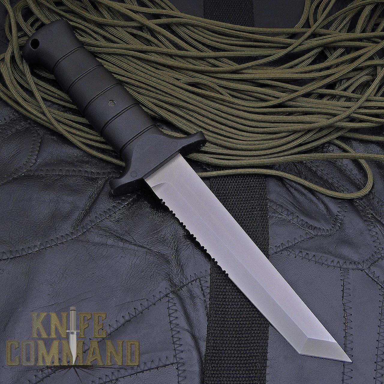 Eickhorn Solingen KM 1000 Combat Knife.  A partially serrated cutting edge.