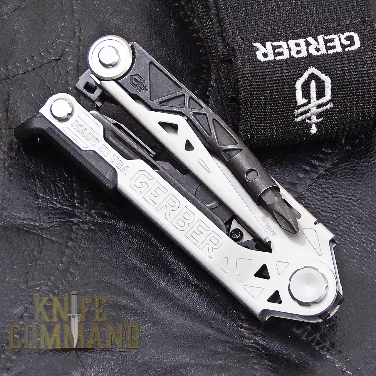 Gerber Center-Drive Multi-Tool Pliers with Sheath and Bit Set.   Folds up compact.
