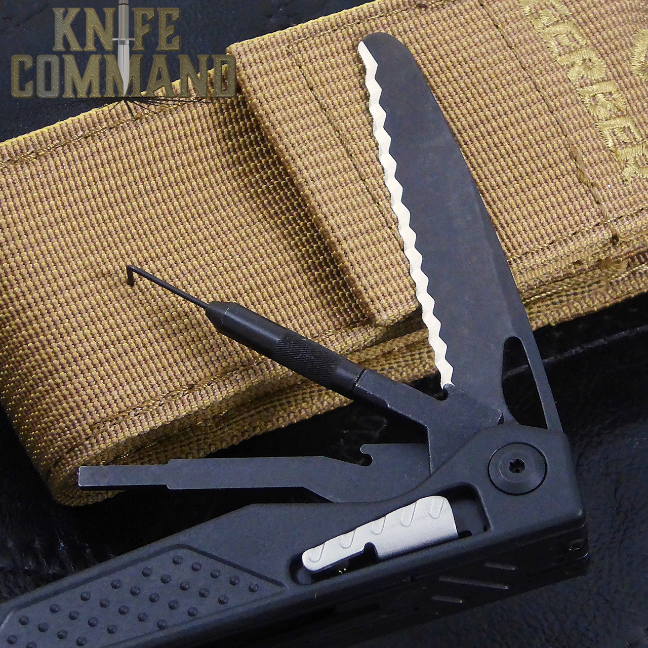 Gerber MP1-AR Weapons Multi-Tool Butterfly Opening Multi-Tool.  Serrated blade, pin punch for take-down pins, dental style carbon pick for cleaning the bolt's ejector area and other hard-to-reach parts of the weapon.