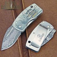 G Sakai Ukimon Ukiyo-e Kinkakuji Money Clip Pocket Knife Damascus 11608.  Beautiful artwork and Damascus blade.