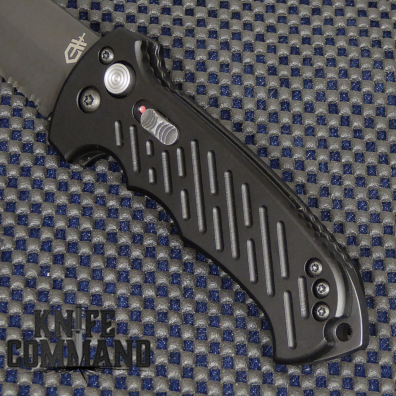 Gerber 06 Auto Tanto Blade Automatic Knife Plain Edge 30-001297.  Extended striking point.