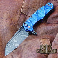 Wander Tactical Custom Mistral Blue Maple TI Extreme Duty Folding Knife Ice Brush.  Blue Maple with bronzed hardware.