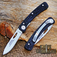 Black Sure Grip handle with clip.  Drop point blade.
