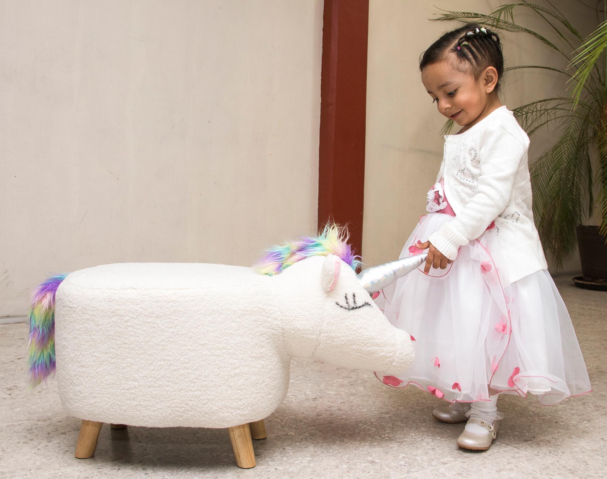smile-train-little-girl-with-unicorn-stool.jpg