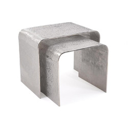 A Set of Textured Nesting Tables in Nickel