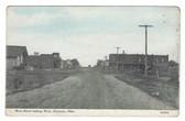 Chouteau, Oklahoma Postcard:  Main Street Looking West & Railroad Station