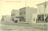 Shell Lake, Wisconsin Postcard:  Street Scene with Bank & Drug Store
