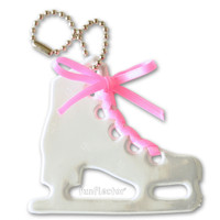 Figure skate soft reflector with pink satin lace and metal ball chain attachment. Width 6.5cm, Height 6cm (2 5/8 by 2 3/8 inches).