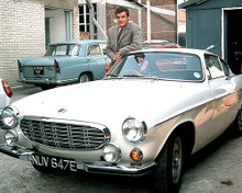 This is an image of 280404 Roger Moore Photograph & Poster