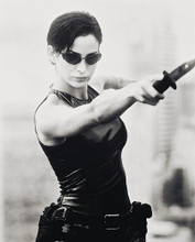 This is an image of 168986 Carrie-Anne Moss Photograph & Poster