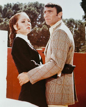 This is an image of 247503 George Lazenby and Diana Rigg Photograph & Poster
