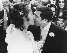 This is an image of 171272 George Lazenby and Diana Rigg Photograph & Poster